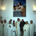 Il gruppo dei benedicenti con Salvatore davanti al quadro appena benedetto